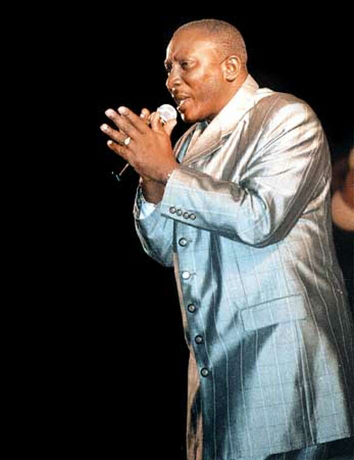 """Winston """"Gypsy"""" Peters sang """"Be Conscious"""" during Carnival 2000 in the Caribbean nation of Trinidad and Tobago. The famous calypso artist, now a member of Trinidad's Parliament, is embroiled in a controversy over his dual citizenship in Trinidad and the United States. Photo courtesy of Trinidad Guardian"""