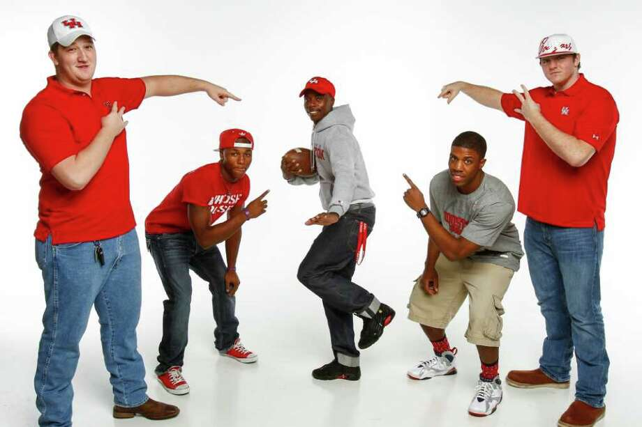 While UH made a splash on the West Coast, it also recruited locally, signing, from left, FB Austin's Jacob Abels, Angleton's Ryan Jackson, North Shore's Larry McDuffey, Eisenhower's Davonte Thomas and Needville's Blake Herman. Photo: Michael Paulsen / © 2011 Houston Chronicle