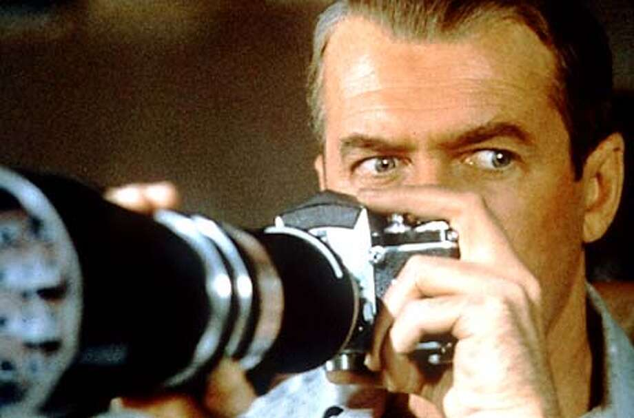 "James Stewart spies on his neighbors in ""Rear Window."" Handout Photo"
