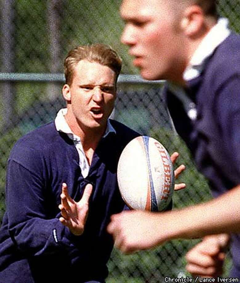 Cal's Mike Freeman, shown catching the ball in practice (as Glen Ryan ran in front of him), says rugby requires far more aerobic conditioning than football. Chronicle Photo by Lance Iverson