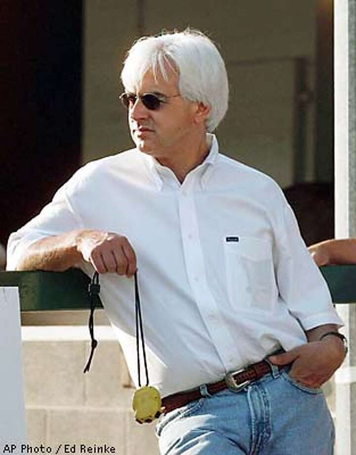 Real Quiet's trainer, Bob Baffert, dangles a stop watch from his hand as he fields questions in the stable area of Churchill Downs in this June 2, 1998 photo, in Louisville, Ky. Baffert has two chances, maybe three, as he tries to become the first trainer to win three straight Kentucky Derbys in the 125th Run for the Roses next Saturday, May 2, 1999.(AP Photo/Ed Reinke) Photo: ED REINKE