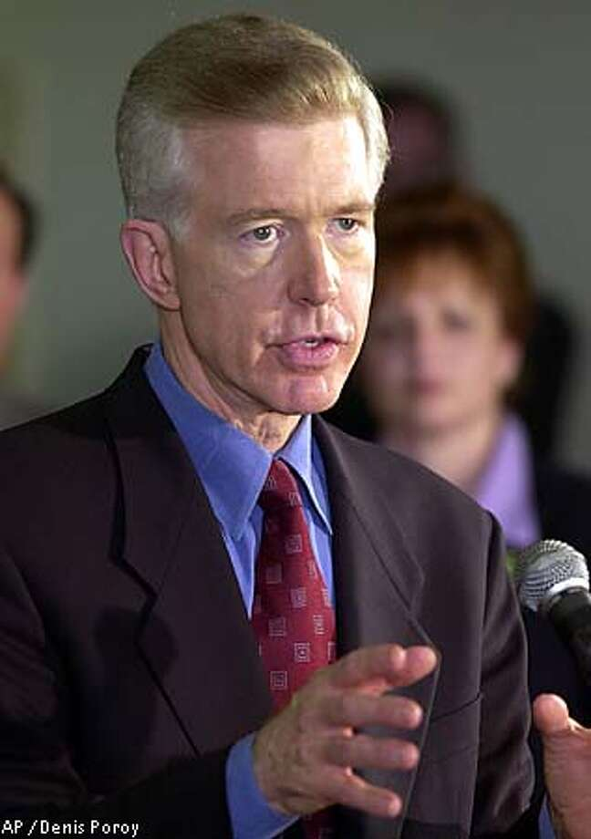 Gov. Gray Davis' critics accused him of protecting his turf with easy promises. Associated Press photo by Denis Poroy