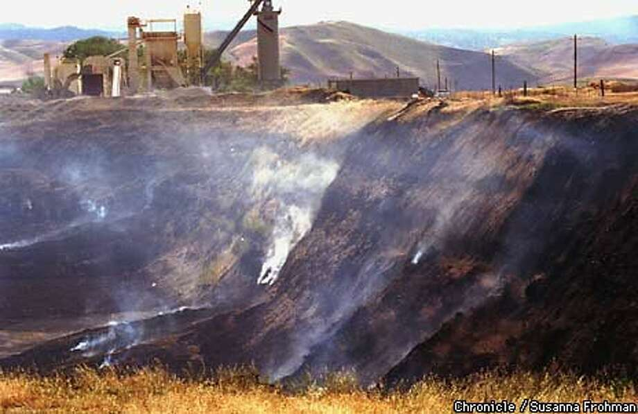 A pile of 7 million discarded tires has been burning near Tracy since August. Chronicle Photo by Susanna Frohman