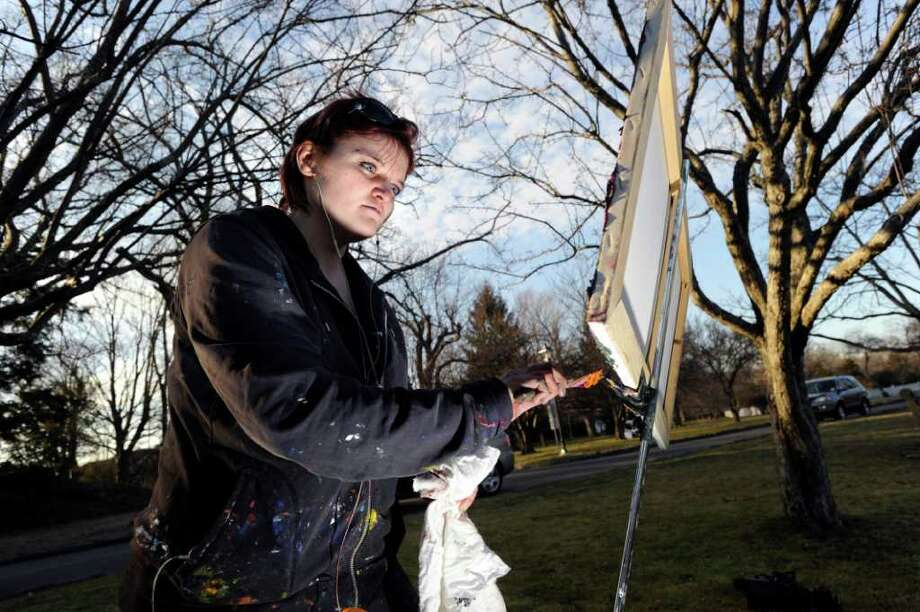 Lacey Fisher of Greenwich paints Bruce Park Pond in Greenwich on an unusually warm Tuesday afternoon, Jan. 31, 2012. Photo: Bob Luckey / Greenwich Time