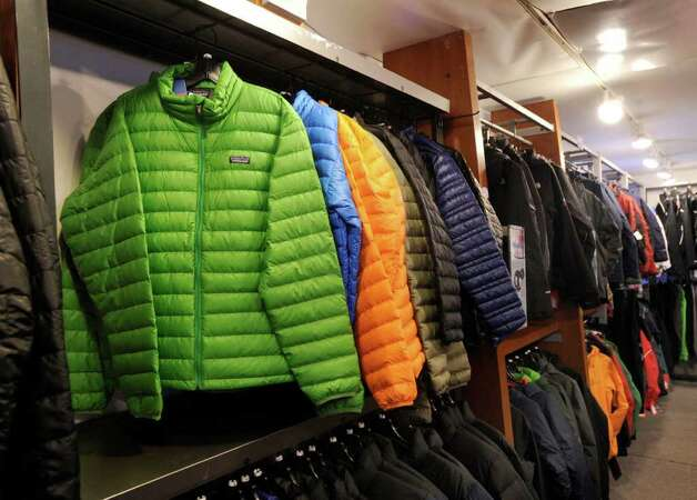 Winter coats on sale at the Outdoor Traders store in Greenwich, Wednesday afternoon, Feb. 1, 2012. Kate Seston, a manager of the store, said the warm weather this winter has had a negative impact on sales of winter apparel. Photo: Bob Luckey / Greenwich Time