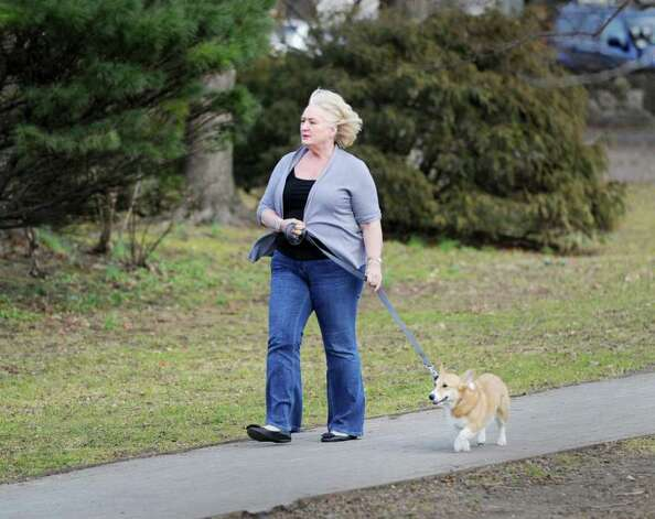 Suzanne Rodda of Greenwich walks her Welsh corgi Eva, without a coat on an unusually warm Wednesday afternoon, Feb. 1, 2012. Photo: Bob Luckey / Greenwich Time