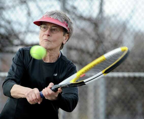 Dellana Schneiderbeck, 65, of New Fairfield, plays singles tennis with her husband, George, 68, at the Rogers Park tennis courts Wednesday, Feb. 1, 2012. Photo: Carol Kaliff / The News-Times