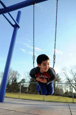 Ryan Pauta, 4, plays on the swings at John J. Boccuzzi Park on Tuesday, January 31, 2012. Photo: Lindsay Niegelberg / Stamford Advocate