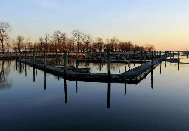 A serene sunset falls on the docks at Cove Island Park on Tuesday, January 31, 2012. Photo: Lindsay Niegelberg / Stamford Advocate