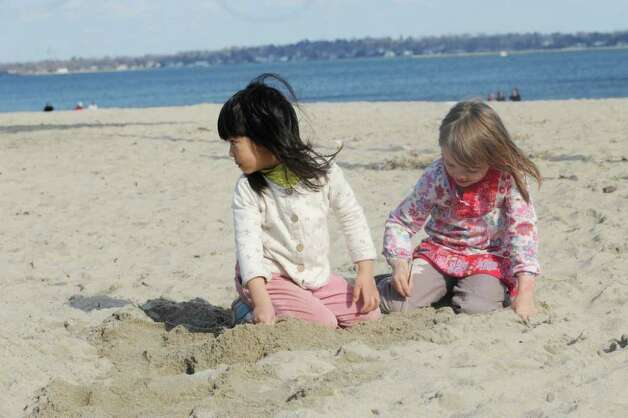 Alianor Sefton, left, and Jane Edwards, 4, of Riverside, play in the sand at Greenwich Point Wednesday, Feb. 1, 2012. Photo: Helen Neafsey / Greenwich Time