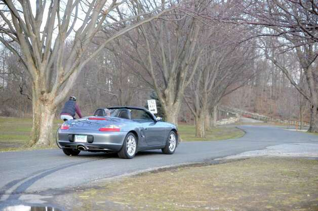 A man drives an open convertible at Greenwich Point o a warm winter afternoon Wednesday, Feb. 1, 2012. Photo: Helen Neafsey