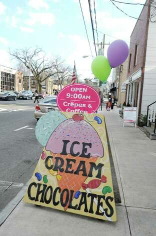 Darlene's Heavenly Desires Chocolates and Ice Cream displays a sign outside for ice cream at Sound Beach Avenue Wednesday, Feb. 1, 2012. Photo: Helen Neafsey / Greenwich Time