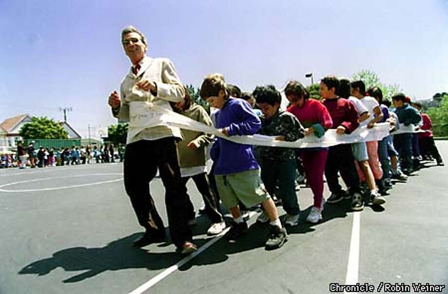 Tom Ammiano, president of the San Francisco Board of Supervisors, is wrapped in a canvas printed with poems as he leads a conga line of second and third graders at Buena Vista Alternative Elementary in San Francisco. April is National Poetry month and California poets in the schools celebrate throughout the Bay Area.  BY ROBIN WEINER/THE CHRONICLE Photo: ROBIN WEINER