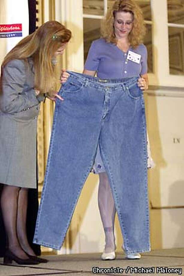 Shannon Ward (right) of Hayward proudly shows the ex Duchess of York her old jeans she wore prior to joining Weight Watchers. She lost 100 lbs in one year.  Sarah is a spokeperson for the diet firm and was at the Palace Hotel talking to over 300 Weight Watchers.  Photo by Michael Maloney Photo: MICHAEL MALONEY