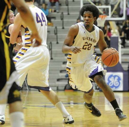 UAlbany's Gerardo Suero drives to the basket against UMBC during a basketball game at the SEFCU Aren