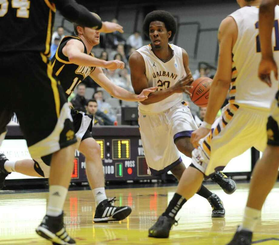 UAlbany's Gerardo Suero drives to the basket against UMBC during a basketball game at the SEFCU Arena on Wednesday, Feb. 1, 2012 in Albany, N.Y.   (Lori Van Buren / Times Union) Photo: Lori Van Buren