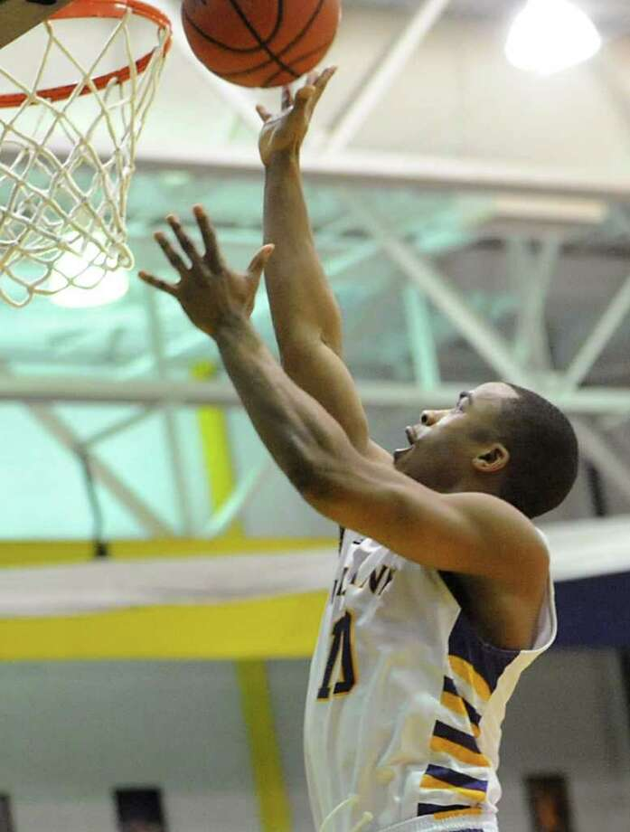 UAlbany's Mike Black makes a layup after a steal and assist from another player against UMBC during a basketball game at the SEFCU Arena on Wednesday, Feb. 1, , 2012 in Albany, N.Y.   (Lori Van Buren / Times Union) Photo: Lori Van Buren