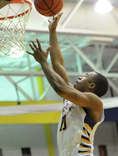 UAlbany's Mike Black makes a layup after a steal and assist from another player against UMBC during