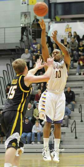 UAlbany's Mike Black makes a three pointer against UMBC during a basketball game at the SEFCU Arena