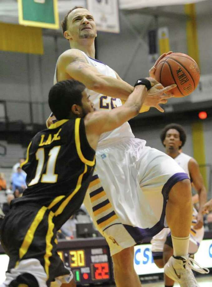 UAlbany's Ralph Watts tries to get around Jarrel Lane of UMBC during a basketball game at the SEFCU Arena on Wednesday, Feb. 1, 2012 in Albany, N.Y.   (Lori Van Buren / Times Union) Photo: Lori Van Buren