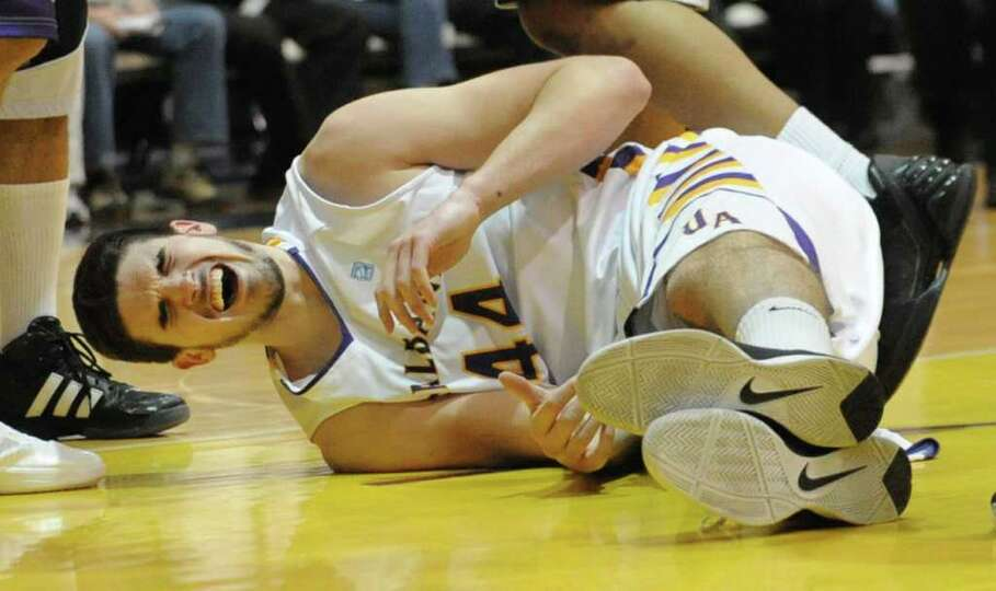 UAlbany's John Puk shows his pain after getting fouled during a basketball game against UMBC at the