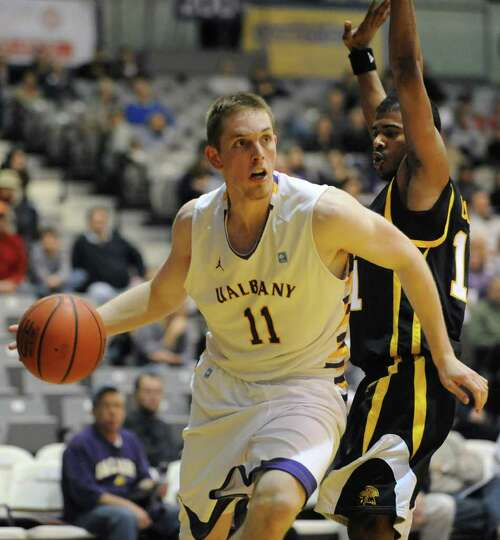 UAlbany's Luke Devlin drives to the basket against UMBC's Jarrel Lane during a basketball game at th