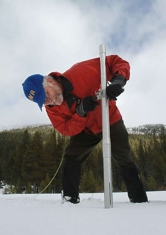 Frank Gehrke, chief of snow surveys for the Department of Water Resources, checks the snowpack depth during the snow survey near Echo Summit Calif., Wednesday, Feb. 1, 2012. Despite recent storms the survey showed the snow pack to to only 15.6 inches deep with a water content of only 3.8 inches which is only 19 percent of normal for this location at this time of the year. Photo: Rich Pedroncelli, Associated Press