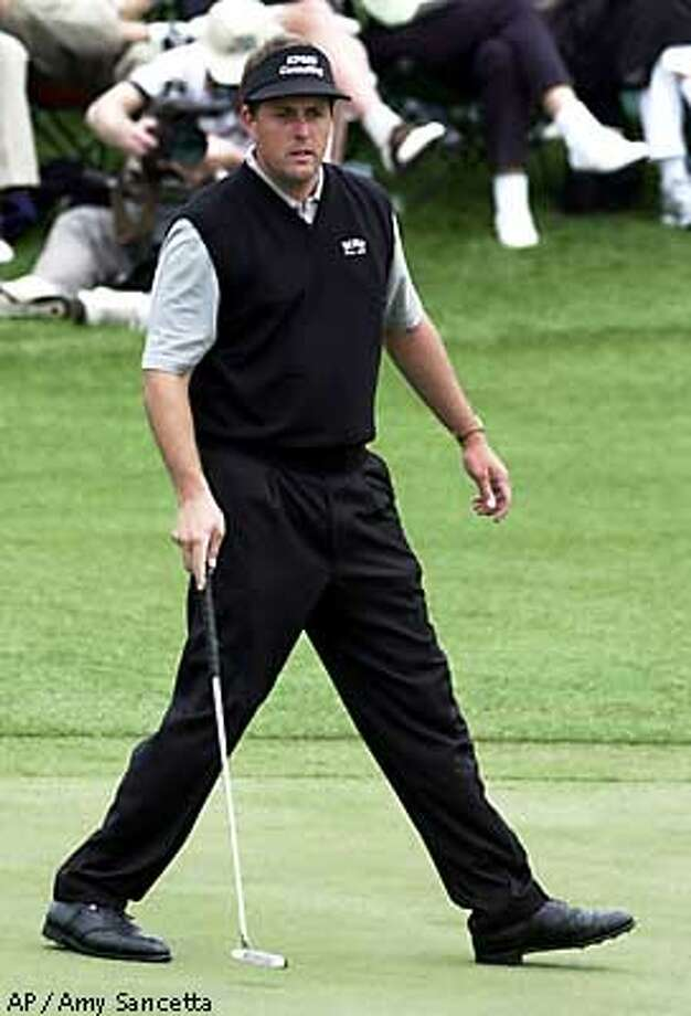 Phil Mickelson walks as his ball rolls toward the cup on a birdie attempt at the 18th hole but misses, during the first round of the 2001 at the Augusta National Golf Club in Augusta, Ga., Thursday, April 5, 2001. Mickelson finished the day at 5-under par 67. (AP Photo/Amy Sancetta) Photo: AMY SANCETTA