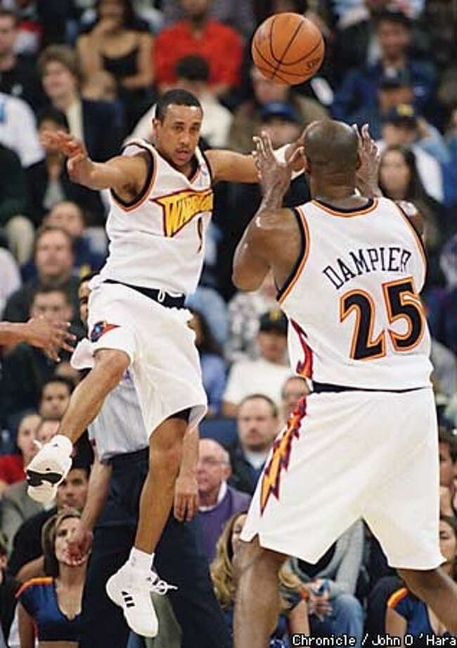 The Warriors' John Starks went flying to keep the ball from going out of bounds and send it back to teammate Erick Dampier. Chronicle Photo by John O'Hara