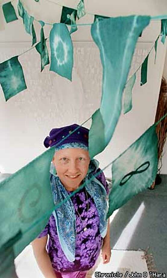 San Rafael,CA.  Artist, Virgina Ray among her paper prayer flag's. Which will be in a show at the Community Congregational Church show in Tiboutrn  Photo/John O'Hara Photo: John O'Hara