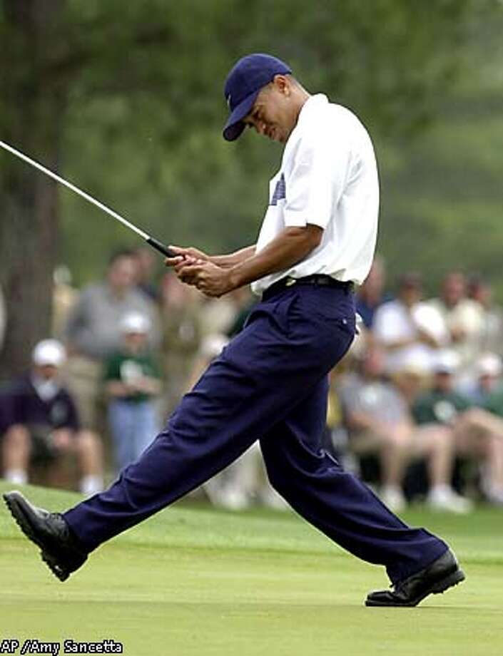 Tiger Woods kicked his leg as his eagle attempt misses on the eighth hole. Associated Press photo by  Amy Sancetta