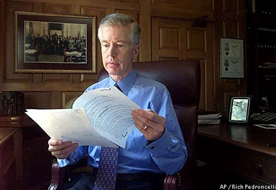 Gov. Gray Davis looks over a copy of his speech concerning California's energy crisis. Associated Press photo by Rich Pedroncelli