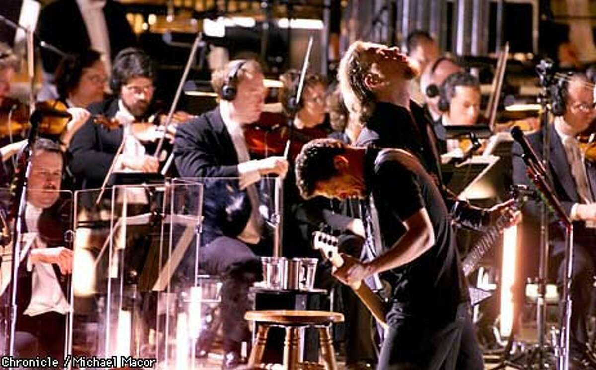 Metallica's Jason Newsted (left) and James Hetfield played with the San Francisco Symphony as the heavy-metal band teamed up with the orchestra for two concerts in Berkeley. Chronicle Photo by Michael Macor