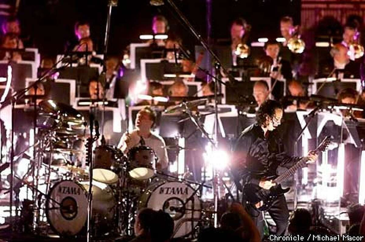 Metallica's Lars Ulrich (drums) and Kirk Hammett played with the San Francisco Symphony as the heavy-metal band teamed up with the orchestra for two concerts in Berkeley. Chronicle Photo by Michael Macor
