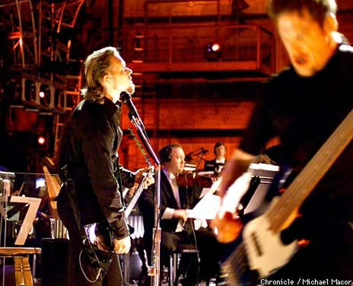 Metallica's James Hetfield (left) and Jason Newsted played with the San Francisco Symphony as the heavy-metal band teamed up with the orchestra for two concerts in Berkeley. Chronicle Photo by Michael Macor
