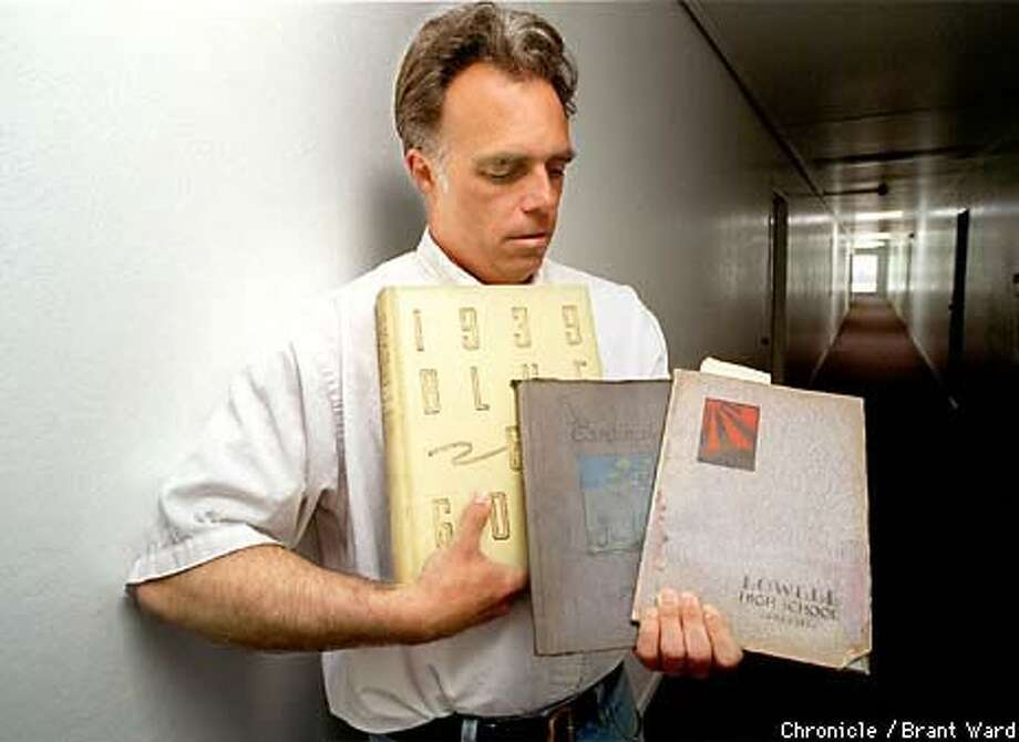 Keith Collins displayed three of his favorite yearbooks -- including Cal 1939 and Lowell High 1930 -- in the hallway of his Millbrae apartment building. Chronicle Photo by Brant Ward