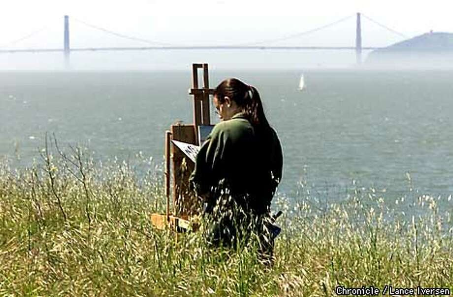 WEATHER-C-30MAR01-EZ-LI  Hannah Bluham from Berkeley paints a landscape of the bay from the bluffs over looking berkeley's Cesar Chavez Park at Berkeley's waterfront . Hannah said she plans to stay as long as the sun shines, as fog started to roll into and over the golden gate Bridge in the back round. By LANCE IVERSEN/SAN FRANCISCO CHRONICLE Photo: LANCE IVERSEN