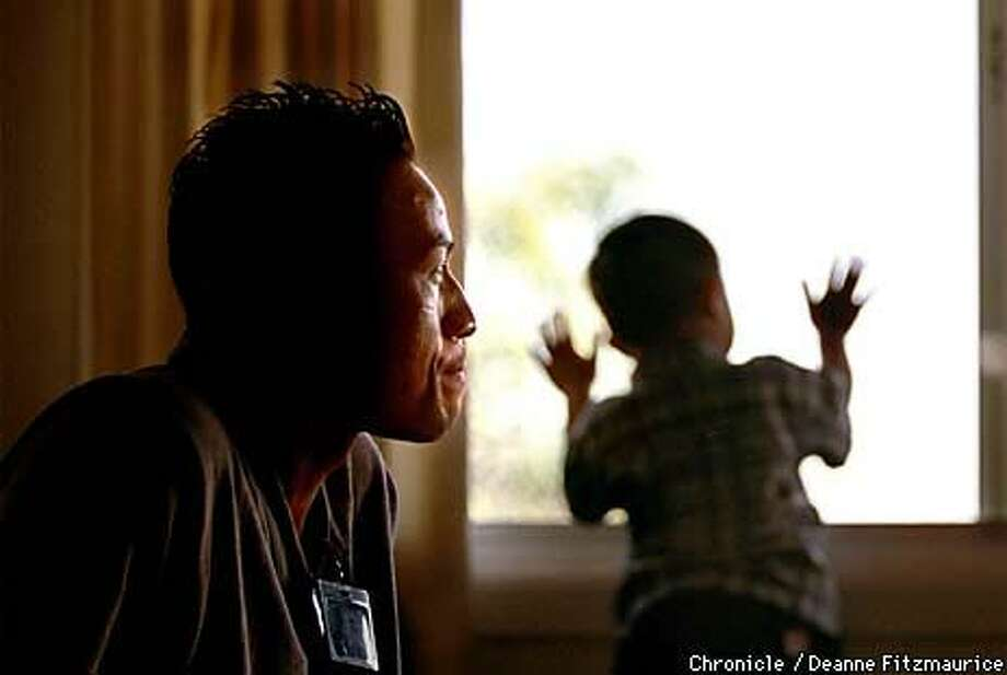 This week's schoolyard shootings caused Narin Hor (left, shown with his 20-month-old nephew, Alvin) to recall when a gunman opened fire on him and his schoolmates at a Stockton elementary school 10 years ago. Chronicle Photo by Deanne Fitzmaurice