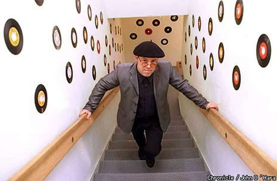 Thomas Dolby Robertson ascended to his San Mateo office through a stairwell lined with 45 records. He had a tech-pop hit in the 1980s. Chronicle Photo by John O'Hara