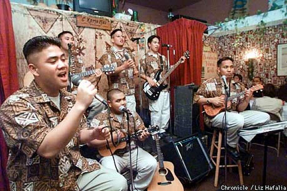 "The Mango Kingz playing at the Punahele Island Grill.Singer is Derrick Posadas (cq), ukulele player that's seated is Arturo ""King"" Bautista (cq), ukulele player at right is Randy Domingo (cq), left to right on top is Janjay Coquilla (cq), Alan (check this name), and Rodney Domingo (cq).  (BY LIZ HAFALIA/THE SAN FRANCISCO CHRONICLE) Photo: LIZ HAFALIA"