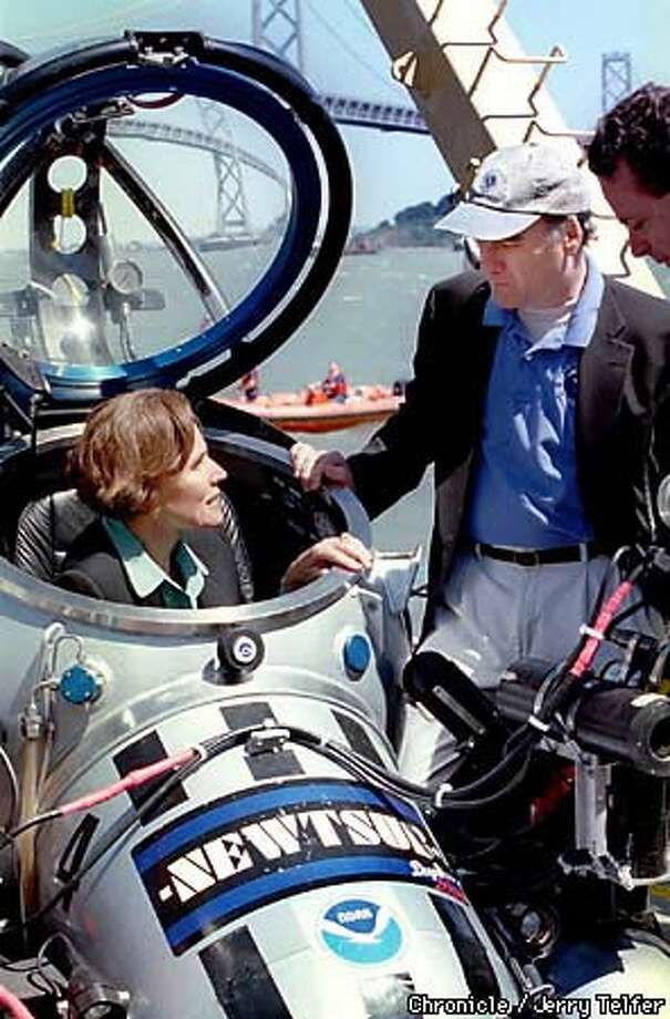 U.S. Secretary of Commerce William M. Daley, right, observed oceanographer Sylvia Earle as she explained some of the features of the one-person submersible she was sitting in, used to explore marine refuges. Chronicle Photo by Jerry Telfer