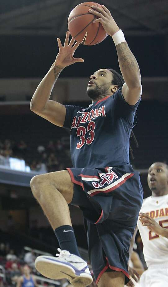 Arizona forward Jesse Perry (33) goes for a layup as Southern California guard Byron Wesley defends in the first half of an NCAA college basketball game on Sunday, Jan. 8, 2012, in Los Angeles. (AP Photo/Jason Redmond) Photo: Jason Redmond, Associated Press