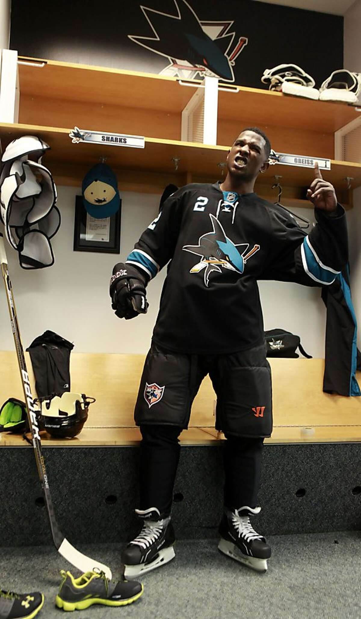 Milwaukee Brewers outfielder Nyjer Morgan suits up Wednesday, February 1, 2012. Morgan lived a dream when he skated with the San Jose Sharks on their practice ice in San Jose.