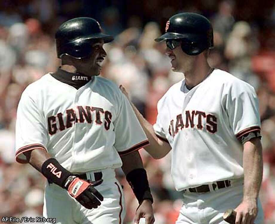 San Francisco Giants' Barry Bonds, left, and Jeff Kent greet each other at home plate after scoring the Giants third and fourth runs against the Montreal Expos during the first inning of their game in San Francisco, Wednesday, Sept. 2, 1998. Bonds had four rbis, homered, and went three for three and Kent added two doubles and four rbi's in the Giants, 12-3, win over the Expos.(AP Photo/Eric Risberg) Photo: ERIC RISBERG