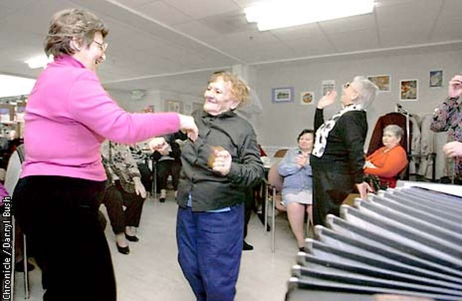 Following the Jewish Shabbat prayer service and meal at the L'Chaim Adult Day Health Center in San Francisco, from left: Larisa Linetskaya, staff aide, dances with Yelena Kundysh, 82, center, as Ida Pivnik sings, background right, during a traditional Russian folk song performed with an accordian (foreground right) and singer (not shown). Chronicle Photo by Darryl Bush Photo: Darryl Bush