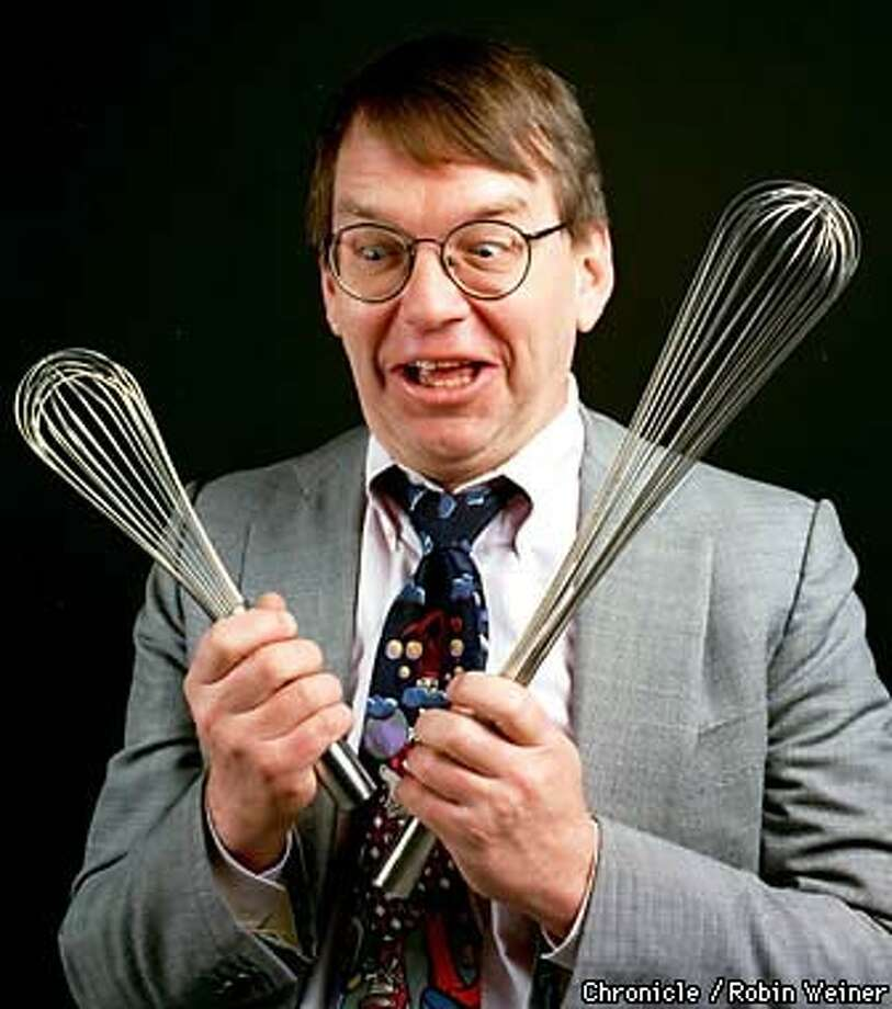 Jamie Jobb of Walnut Creek, who just learned to cook, makes a funny face as he holds two wisks. Chronicle Photo by Robin Weiner