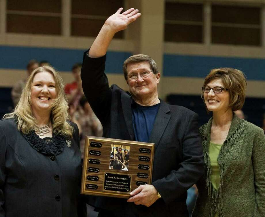 Former San Jacinto basketball coach Scott Gernander, center, is flanked by athletic director Sharon Nelson, left, and volleyball coach Brenda Hellyer as he is honored Wednesday night for his 31-season stint at the school that included 640 wins, 14 conference titles and eight national tournament appearances. Photo: Eric Kayne / © 2011 Eric Kayne