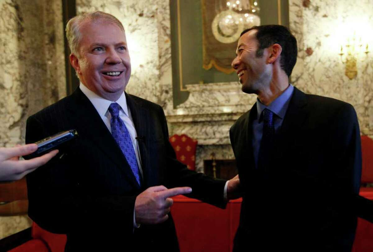 Sen. Ed Murray, D-Seattle, left, and his partner Michael Shiosaka smile as they answer a question about how they met decades earlier during a news conference Wednesday, Feb. 1, 2012, in Olympia, Wash. The state Senate is set to vote Wednesday night on a proposal to legalize same-sex marriage in Washington state. If passed by the Senate, the measure moves to the House, which has enough votes to pass the bill. Democratic Gov. Chris Gregoire supports the measure and said she will sign it into law.