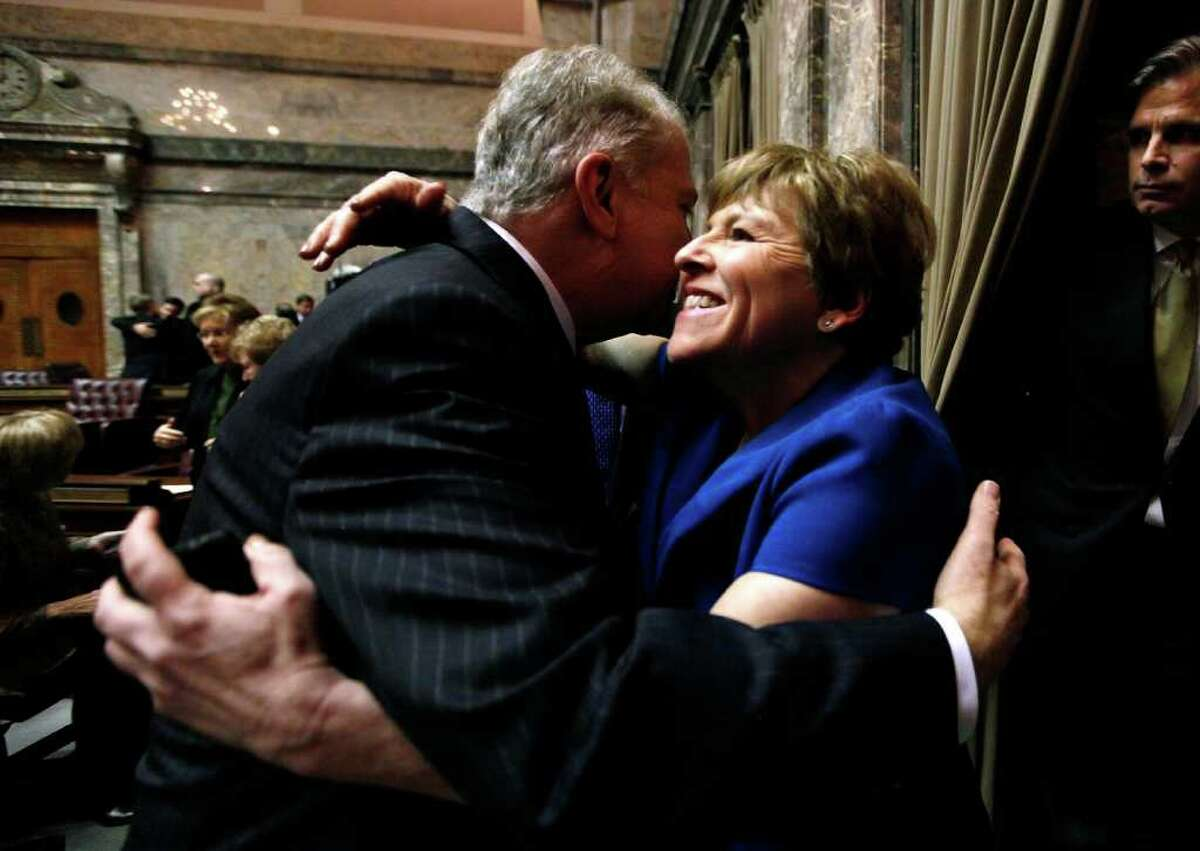 Sen. Lisa Brown, D-Spokane, right, embraces Sen. Ed Murray, D-Seattle, after the Senate voted for a proposal to legalize same-sex marriage Wednesday evening, Feb. 1, 2012, in Olympia, Wash. The measure now moves to the House, which has enough votes to pass the bill. Democratic Gov. Chris Gregoire supports the measure and said she will sign it into law.