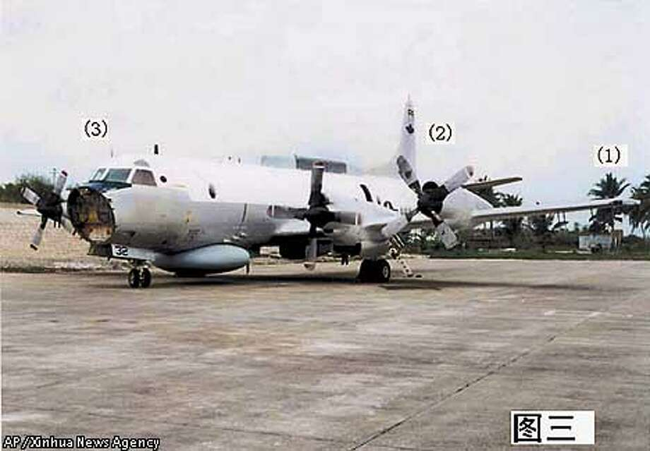 The damaged U.S.Navy EP-3 electronic reconnaissance plane is parked at Lingshui base on China's Hainan Island , Tuesday, April 3, 2001 in this photo released by China's official Xinhua news agency. The U.S. plane landed at the Hainan base after a collision with a Chinese jet fighter on Sunday, April 1, 2001. The numbers in the photo correspond to areas that Xinhua says were damaged in the collision.(AP Photo/Xinhua)